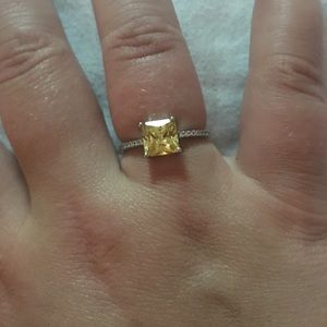 Amber coloured charmed aroma ring